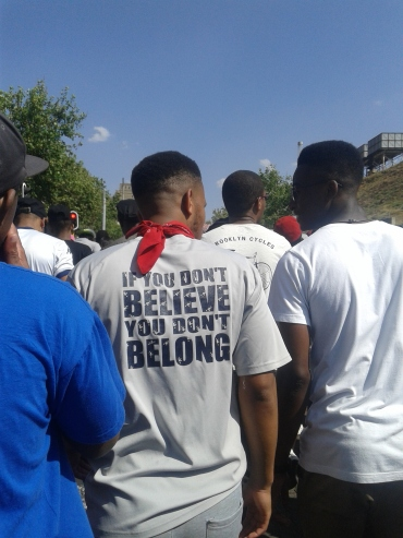 """This student, while marching to COSATU House wears a t-shirt in protest, that reads, """"If you don't believe, you don't belong"""" Photo: Aarti Bhana"""
